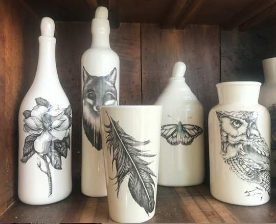Naturalist illustrations on ceramic decanters and housewares by Laura Zindel Design.