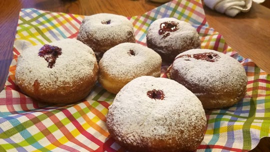 The filled classic sufganiyot are dusted with powdered sugar.