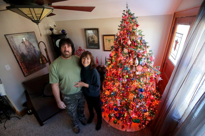 Kim Harrison and her fiancé, Mark Sloan, stand next to the decorated Christmas tree in their Milwaukee home.