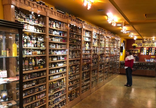 A visitor to the National Mustard Museum in Middleton checks out some of the 6,200 mustard-related items on display.