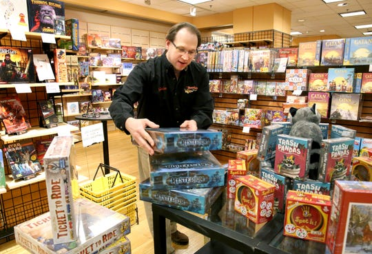 Gordon Lugauer, owner of Board Game Barrister at Bayshore Town Center in Glendale, organizes games in the store late last year. The game, puzzle and toy retailer that has been at Bayshore since 2006 will leave the mall in the next few months for new space at 5530 N. Port Washington Rd.