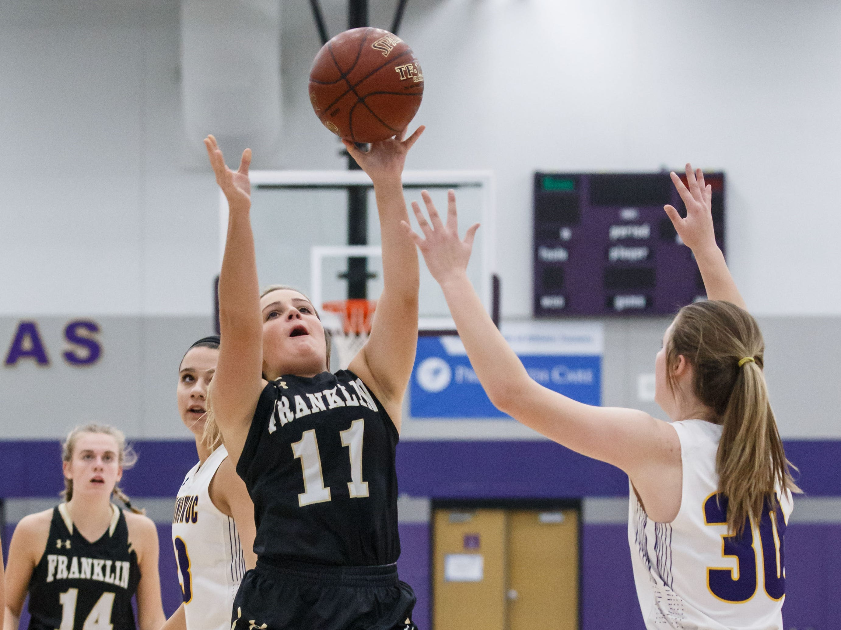 Franklin junior Jillian Krueger (11) drives in for a shot during the game at Oconomowoc on Monday, Nov. 19, 2018.