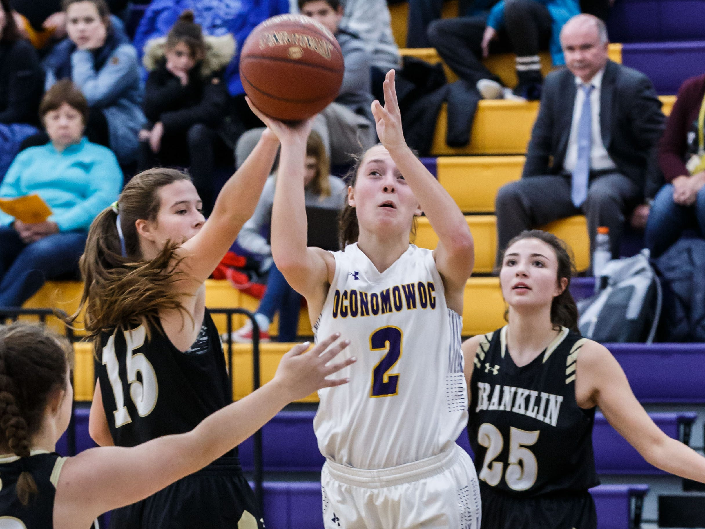 Oconomowoc sophomore Elizabeth Cleary (2) takes flight for a shot during the game at home against Franklin on Monday, Nov. 19, 2018.