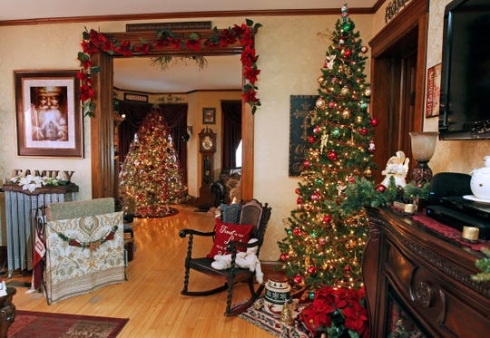 Three large trees and 12 small trees helps spread Christmas spirit throughout the Katonas' home. Every room has a tree.