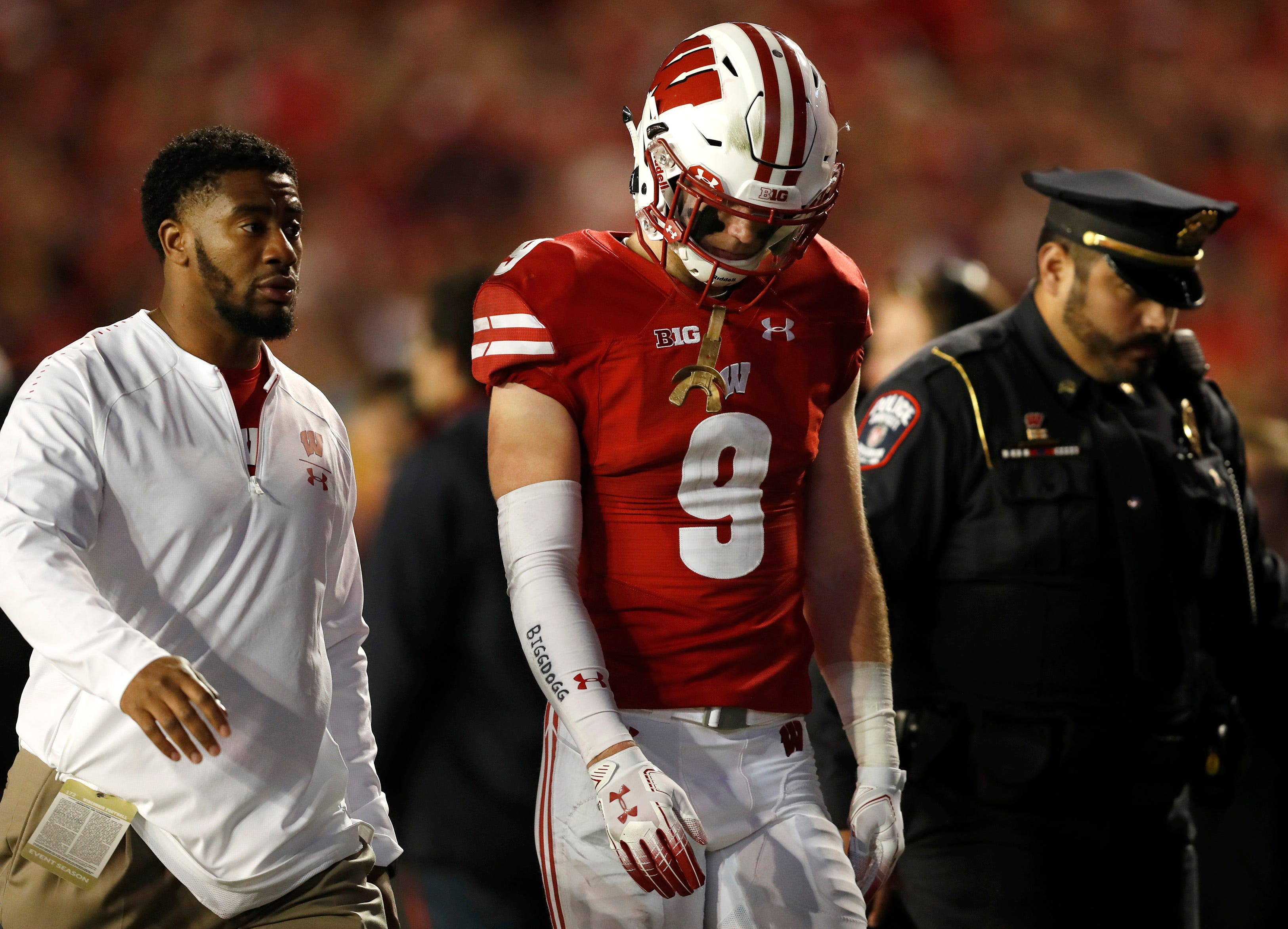 Wisconsin safety Scott Nelson is escorted off the field after being called for targeting  against Nebraska on Oct. 6.