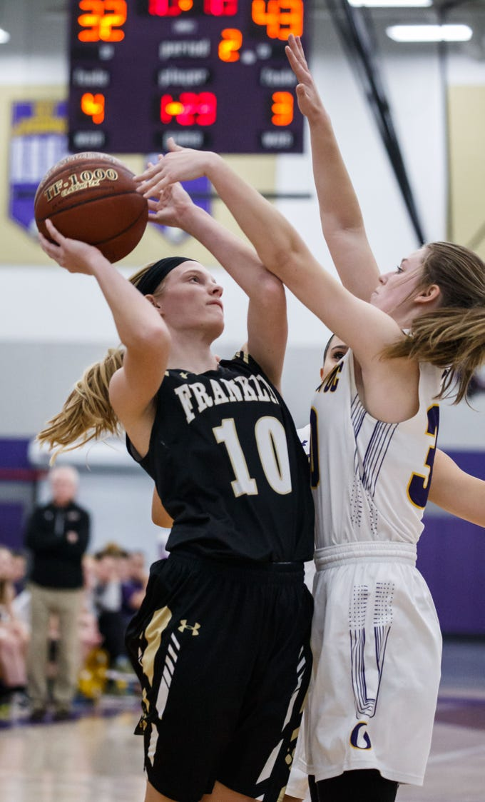 Franklin junior Lauren Schwartz (10) drives to the hoop against Oconomowoc's Caitlin McArthey (30) during the game at Oconomowoc on Monday, Nov. 19, 2018.