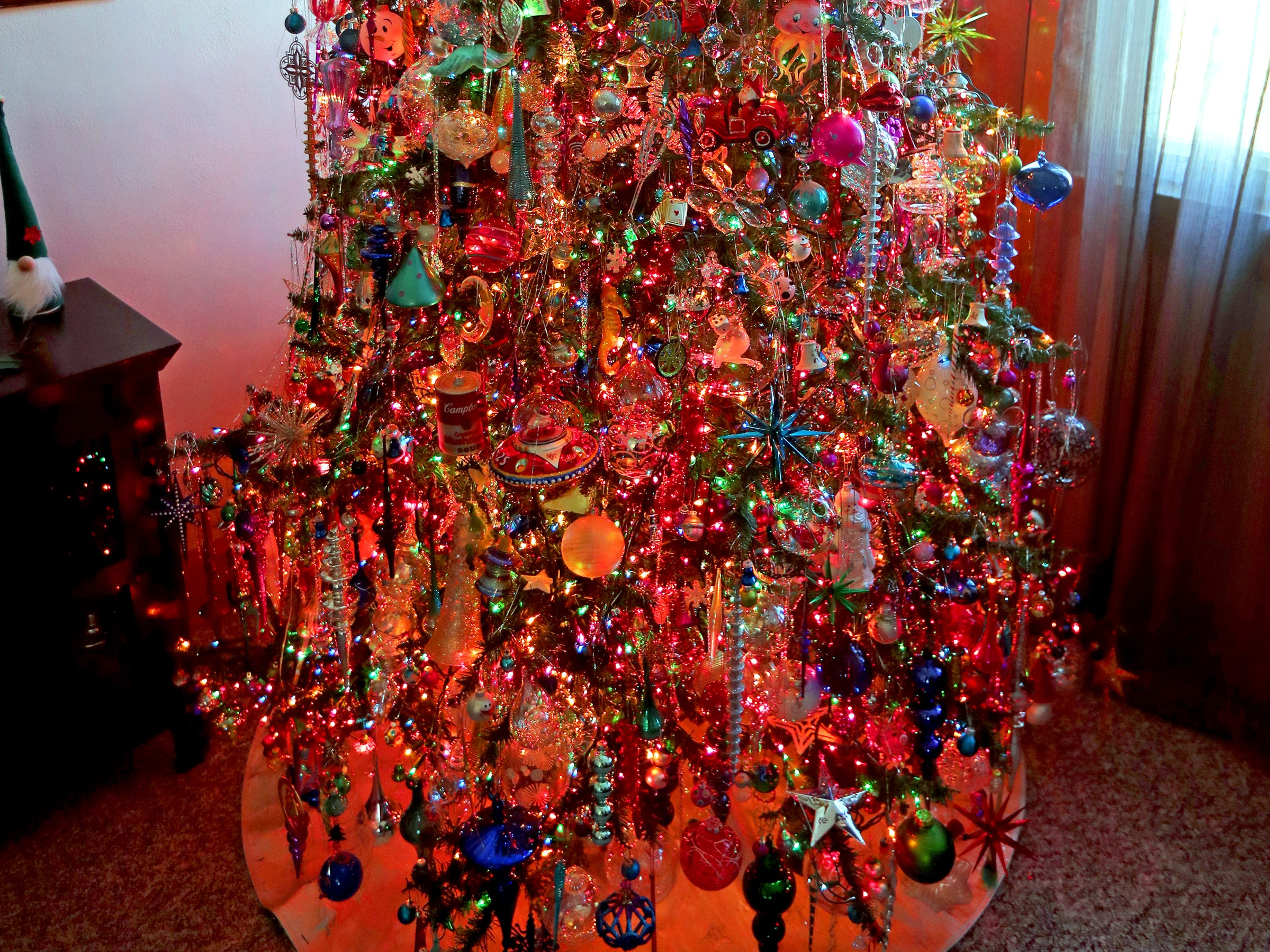 More than 5,000 lights and perhaps 1,000 ornaments adorn the 6 1/2-foot tree in Kim Harrison's home.
