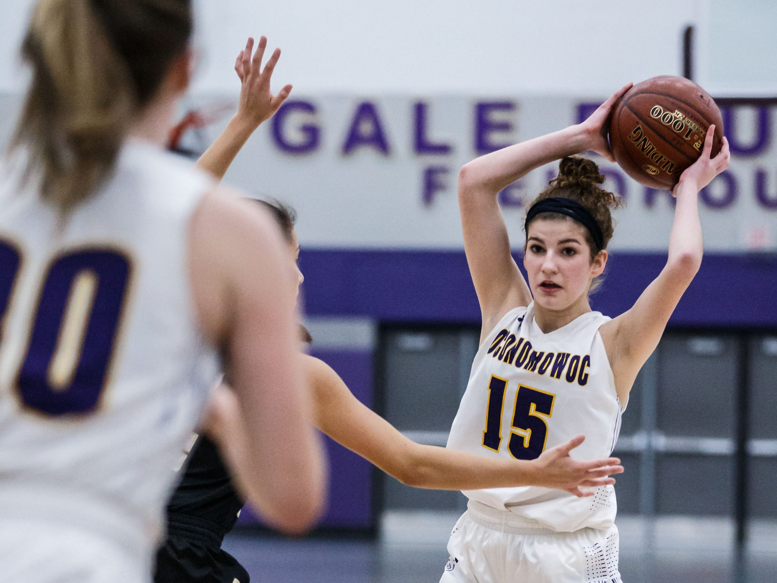 Oconomowoc sophomore Lily Rott (15) looks to pass during the game at home against Franklin on Monday, Nov. 19, 2018.