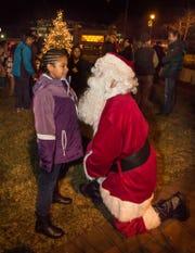Ava Thomas chats with Santa at the Brown Deer community Christmas Tree Lighting celebration.