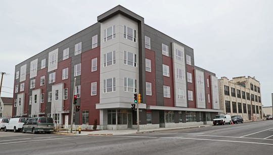 The Legacy Lofts at the Blommer Ice Cream Factory apartment community includes a new four-story building.