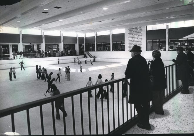 In a 1976 photo, skaters are watched by shoppers at The Ice Chalet In The Mayfair Shopping Center.
