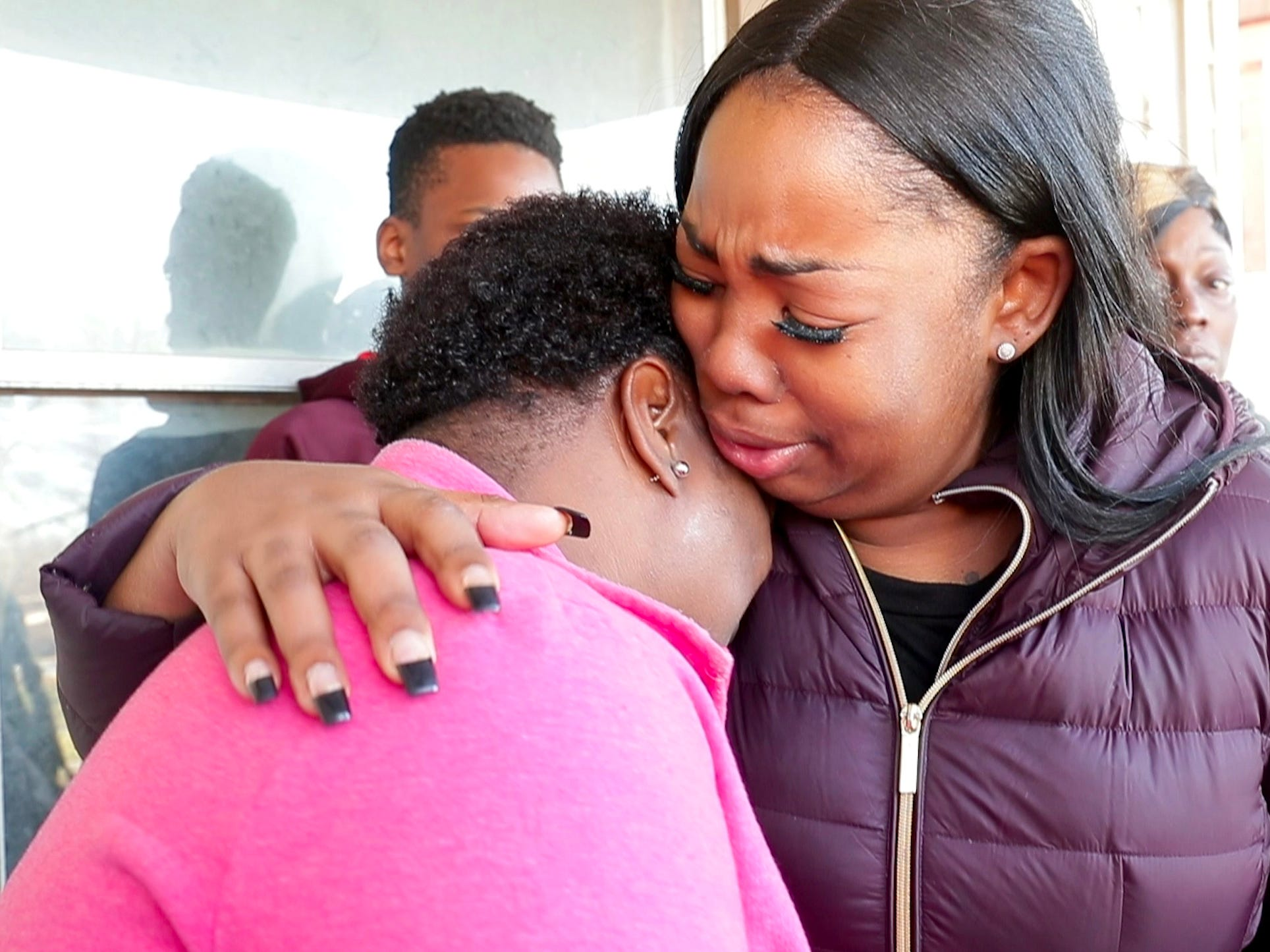 Bernice Parks (left) is consoled by Jasmine Wells after Parks talked about her daughter, 13-year-old Sandra Parks, who was killed after shots were fired into her home about 8 p.m. Monday night.