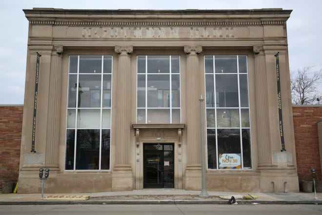 The former BMO Harris bank, which was burned in 2016, now houses Sherman Phoenix. Several new businesses will occupy three floors of retail space.