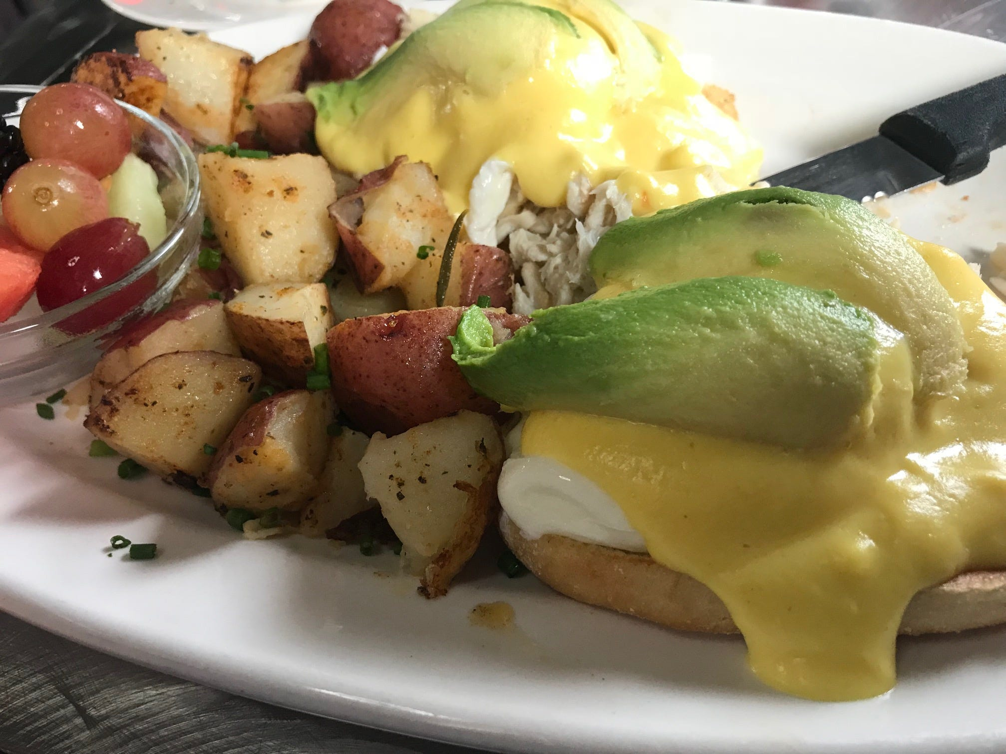 One variation on eggs Benedict at Fiesta Cafe is crabmeat with avocado, served with potatoes and fruit.