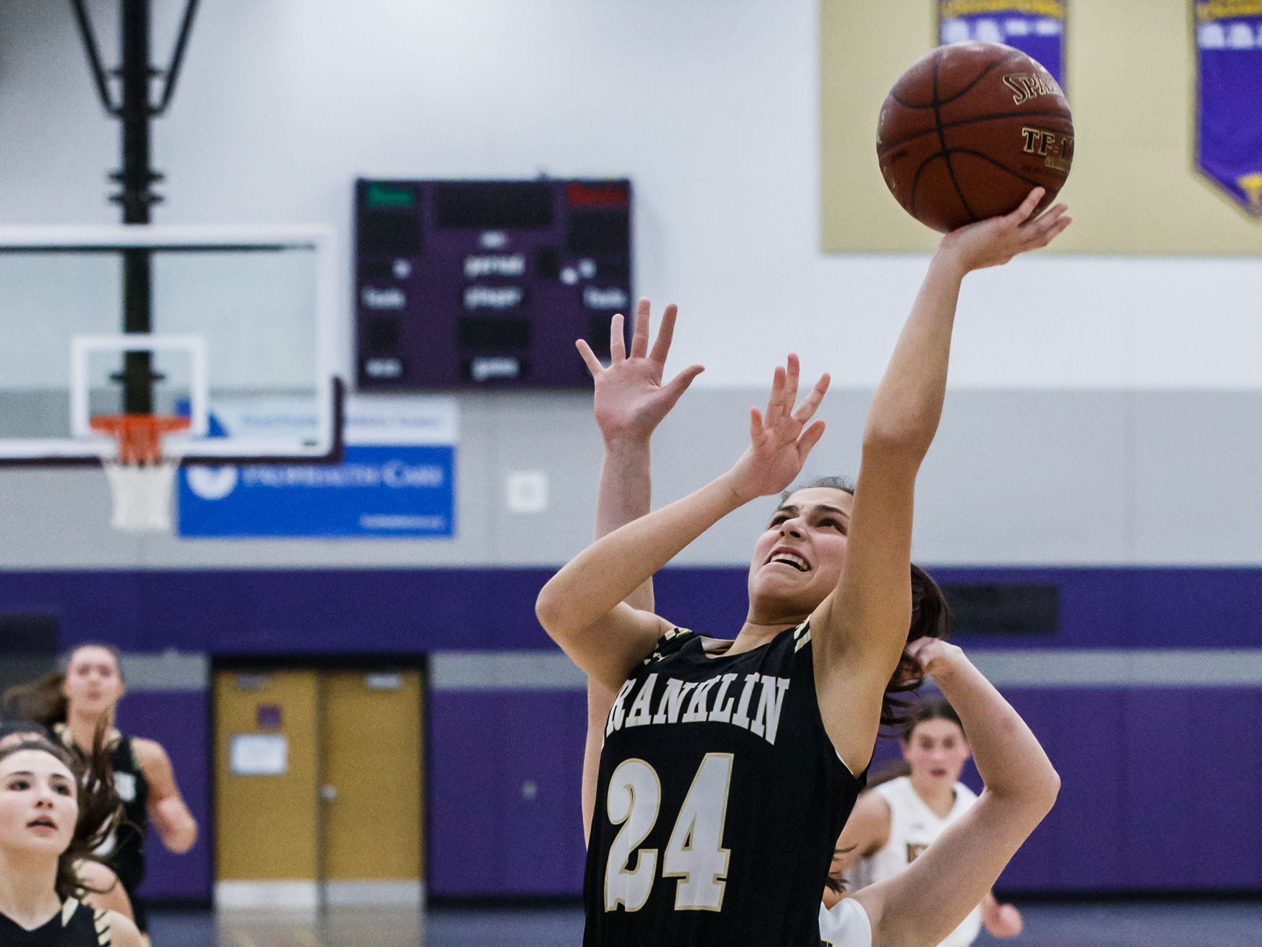 Franklin sophomore Olivia Rangel (24) takes flight for a layup during the game at Oconomowoc on Monday, Nov. 19, 2018.