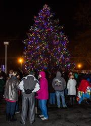Spectators gather to watch a past Okauchee Tree Lighting event.