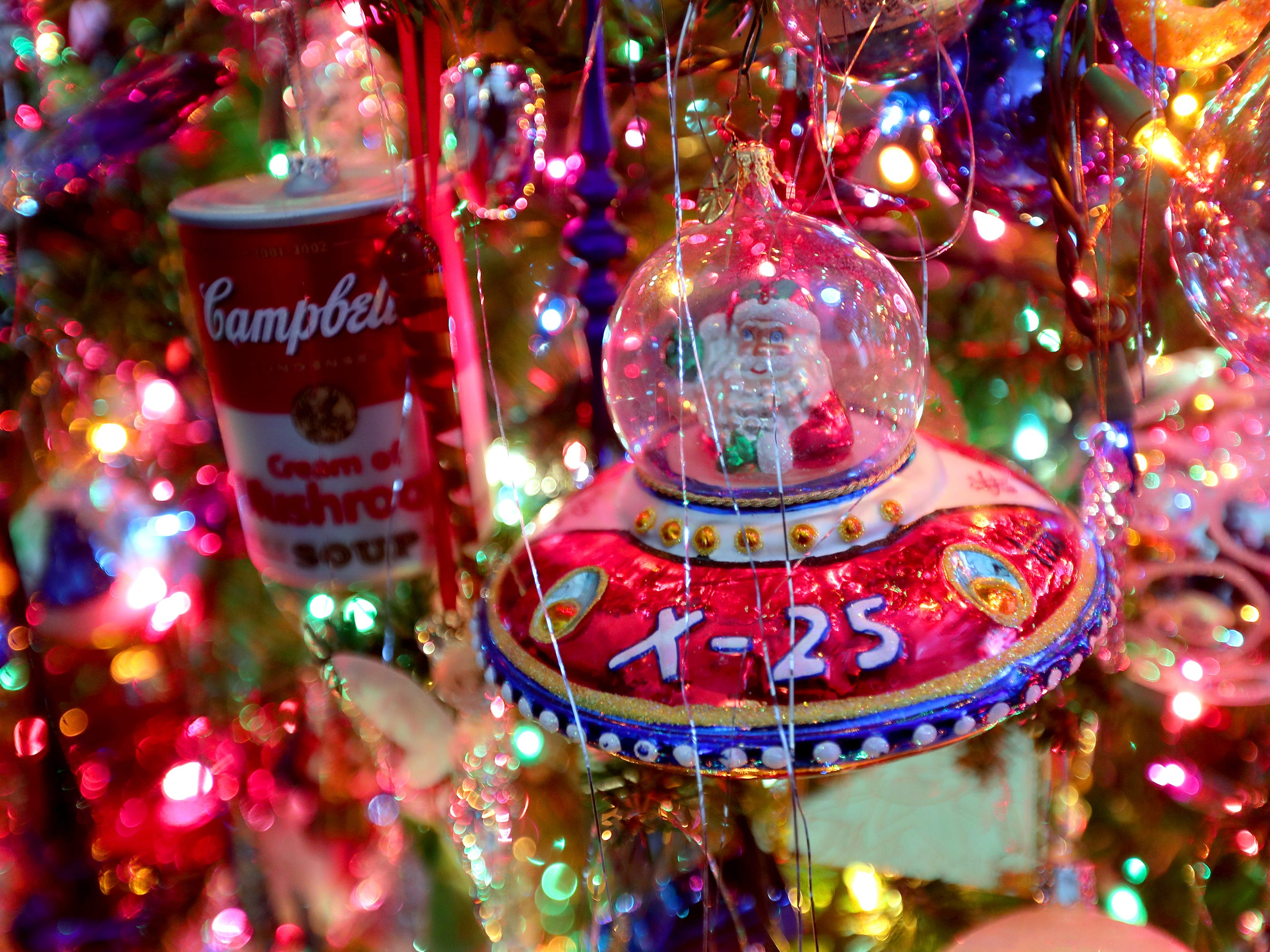 A martian Santa stands out among the nearly 1,000 ornaments on Kim Harrison's tree.