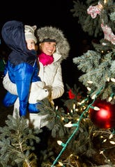 Britta Lehman of Sussex enjoys the decorations with her son Samuel during the 2013 Sussex Tree Lighting.