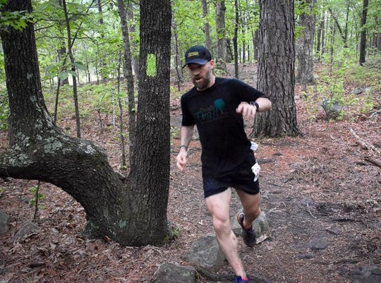 Jake Anderson runs a local trail.