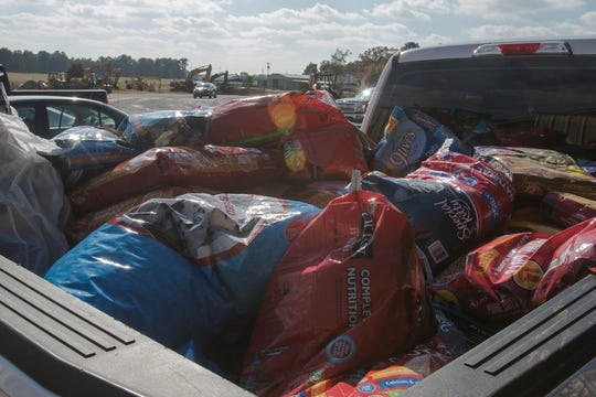 A pickup truck bed is loaded with dog and cat food which has been donated to the Ouachita Parish Animal Shelter in West Monroe, La. on Nov. 20. The shelter put out a call for donations via Facebook earlier in the day after realizing they didn't have enough for the animals.