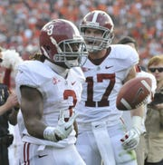 Alabama's Trent Richardson, left, (3) and Brad Smelley (17) after Richardson made a touchdown during their game with Auburn at Jordan-Hare Stadium in Auburn, Ala., on Saturday, Nov. 26, 2011.