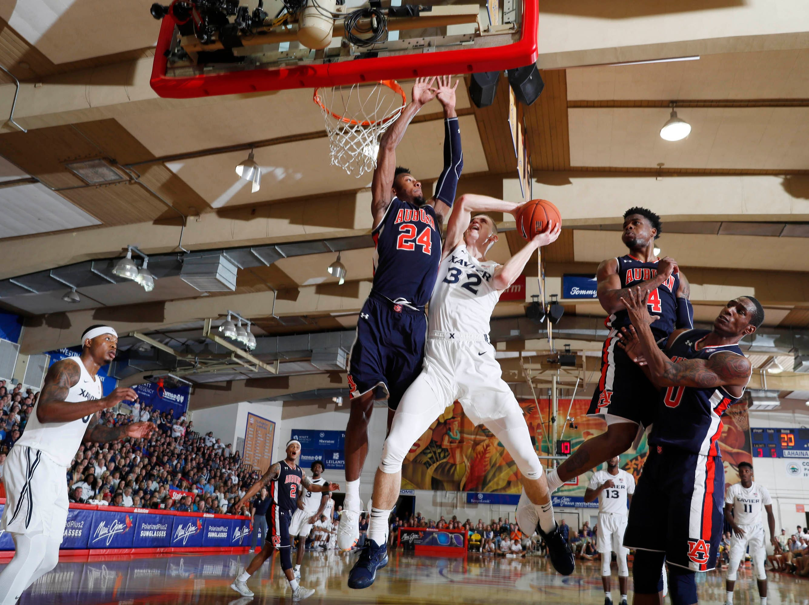 Nov 19, 2018; Lahaina, HI, USA; Xavier Musketeers forward Ryan Welage (32) takes a shot against  Auburn Tigers forward Anfernee McLemore (24) in the first half during the first round games of the Maui Jim Maui Invitational at Lahaina Civic Center. Mandatory Credit: Brian Spurlock-USA TODAY Sports