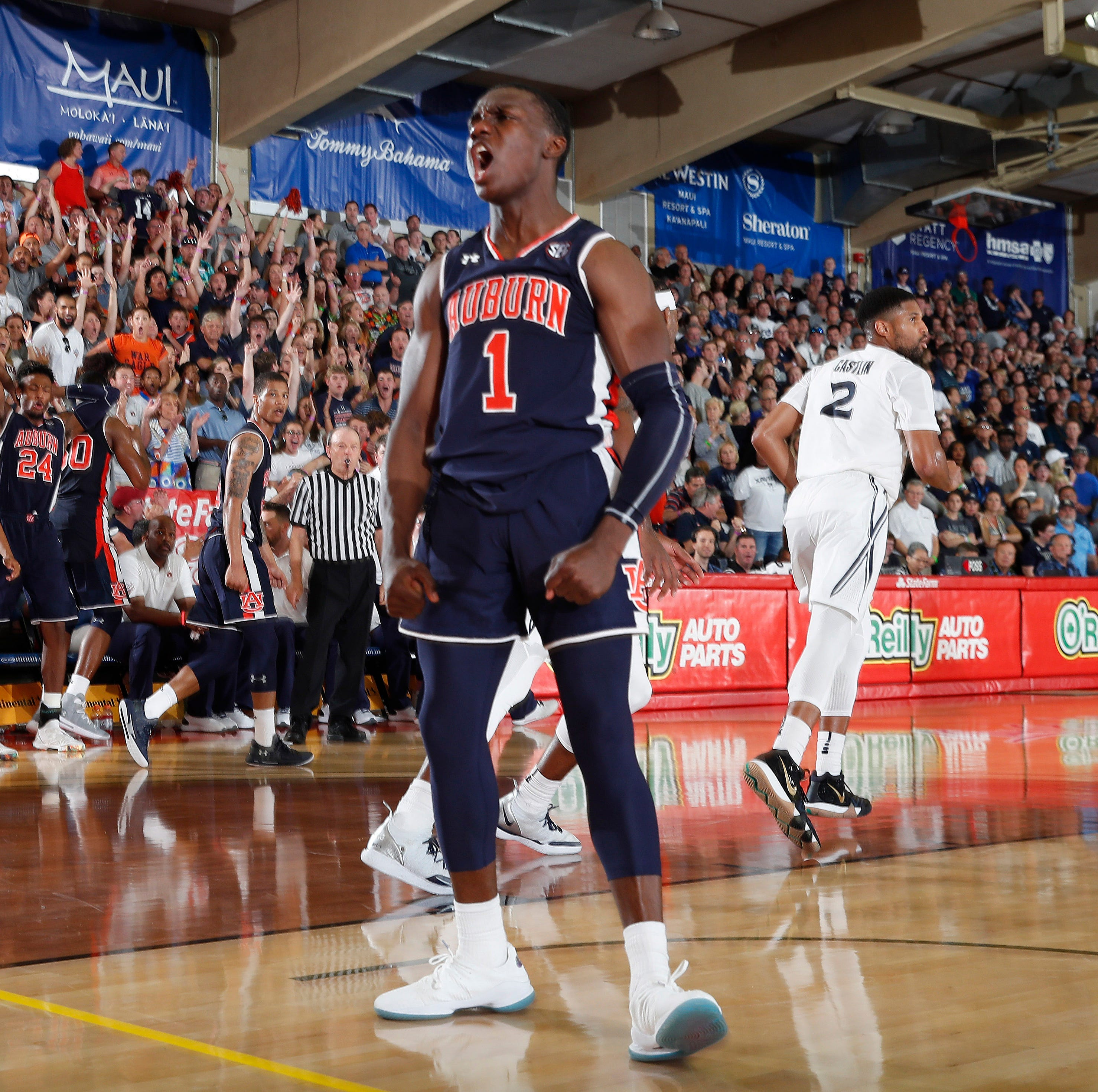 See Auburn's Jared Harper dunk over 3 guys at the Maui Invitational