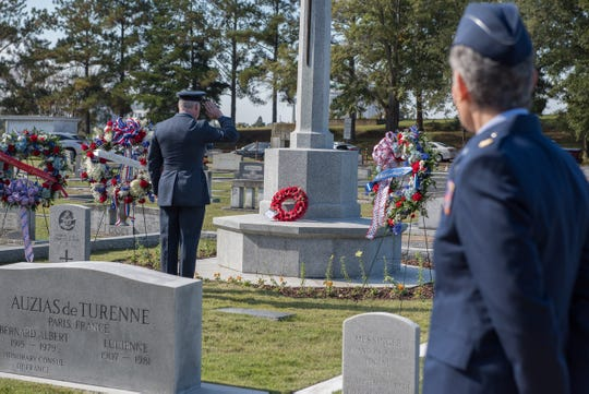 A Royal Air Force officer salutes a wreath on display during the Remembrance Day Service, Nov. 11, 2018, at the Oakwood Cemetery Annex in Montgomery.