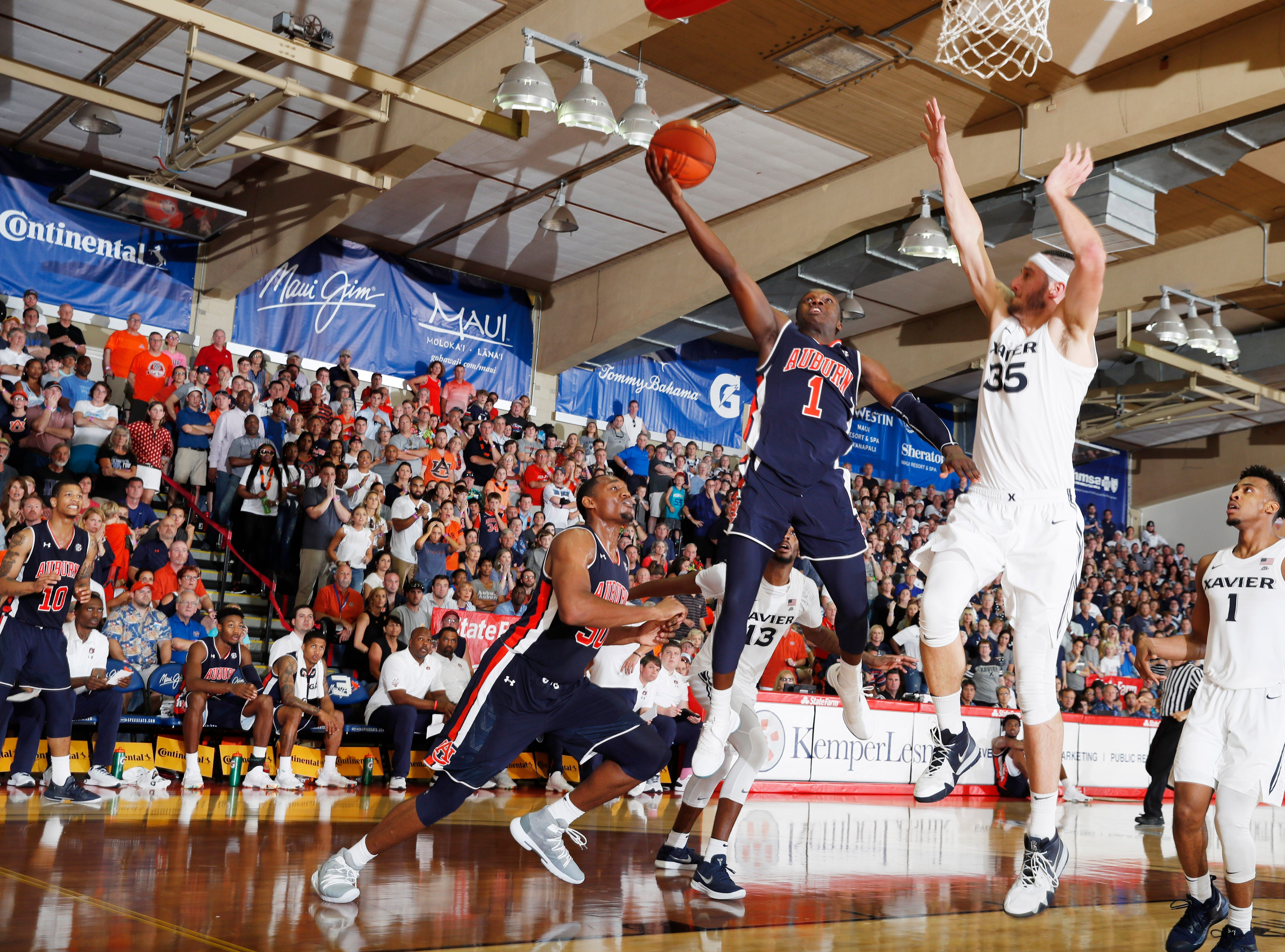 Nov 19, 2018; Lahaina, HI, USA; Auburn Tigers guard Jared Harper (1) takes a shot against Xavier Musketeers forward Zach Hankins (35) in the second half during the first round games of the Maui Jim Maui Invitational at Lahaina Civic Center. Mandatory Credit: Brian Spurlock-USA TODAY Sports