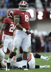 Alabama defensive lineman Jeoffrey Pagan (8) celebrates stopping Auburn running back Tre Mason (21) for a loss in the Iron Bowl at Bryant-Denny Stadium in Tuscaloosa, Ala. on Saturday November 24, 2012.(Montgomery Advertiser, Mickey Welsh)