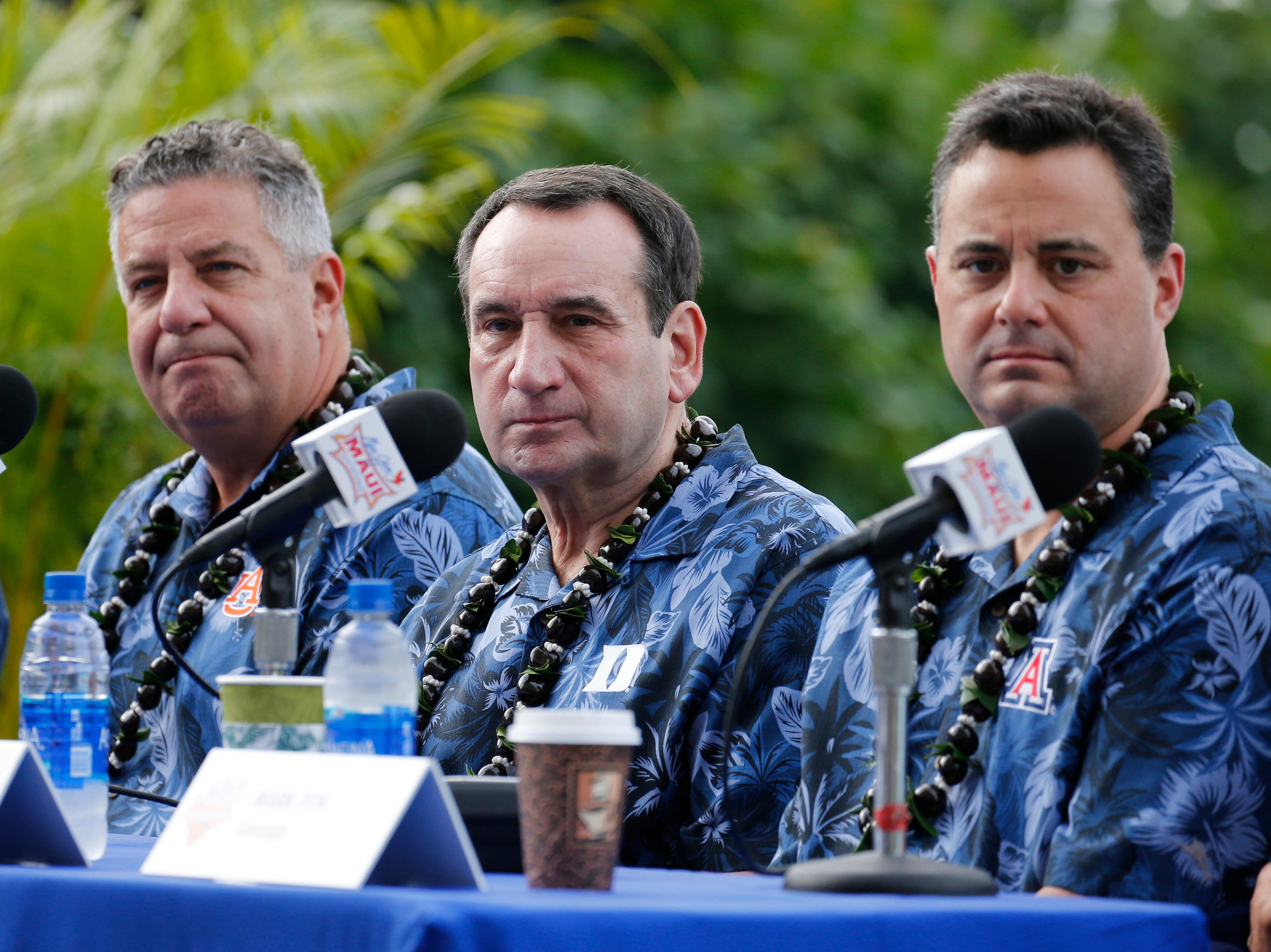 Nov 19, 2018; Lahaina, HI, USA; Duke Blue Devils coach Mike Krzyzewski attends a press conference sitting next to Auburn Tigers coach Bruce Pearl and Arizona Wildcats coach Sean Miller at the Hyatt Regency Resort and Spa before playing against the San Diego Aztecs during round 1 of the Maui Jim Maui Invitational at the Lahaina Civic Center. Mandatory Credit: Brian Spurlock-USA TODAY Sports