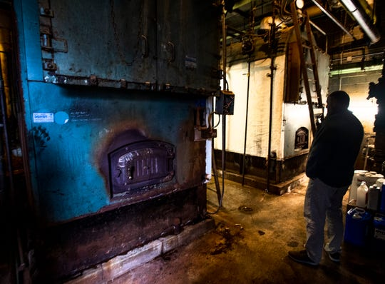 Lee McKenzie, Director of Maintainance of Montgomery Public Schools, checks the boiler room at Jeff Davis High School in Montgomery, Ala., on Tuesday November 20, 2018.
