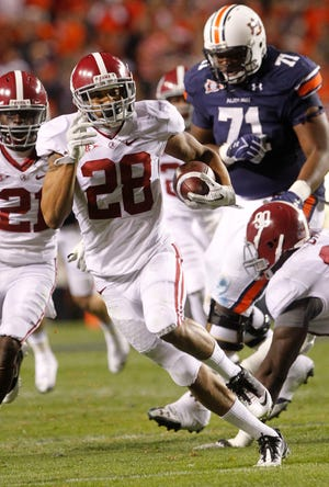 Alabama defensive back Dee Milliner (28) returns an interception of an Auburn pass for a 35-yard touchdown in the second half of the Iron Bowl in Auburn, Ala., Saturday, Nov. 26, 2011.