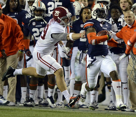 Alabama wide receiver Caleb Sims (29) grabs for Auburn cornerback Chris Davis (11) during the Iron Bowl at Jordan-Hare Stadium on Saturday, Nov. 30, 2013.