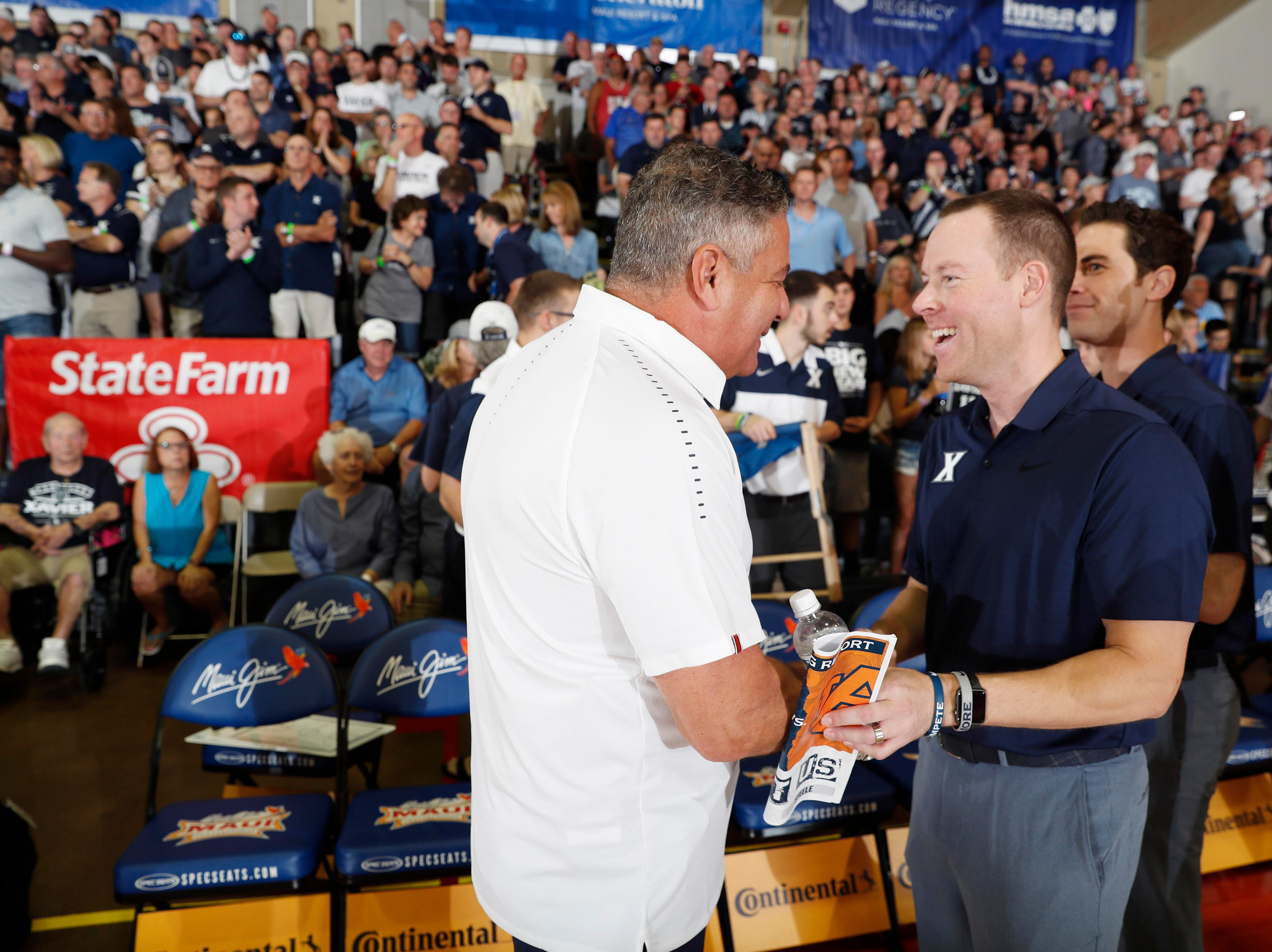Nov 19, 2018; Lahaina, HI, USA; Auburn Tigers coach Bruce Pearl talks before the game with Xavier Musketeers coach Travis Steele during the first round games of the Maui Jim Maui Invitational at Lahaina Civic Center. Mandatory Credit: Brian Spurlock-USA TODAY Sports