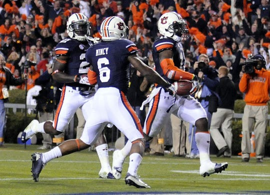 Auburn cornerback Chris Davis (11) scores the winning touchdown during the Iron Bowl at Jordan-Hare Stadium on Saturday, Nov. 30, 2013.