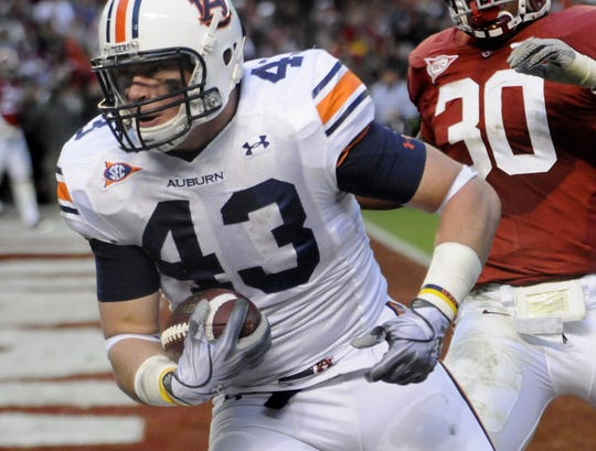 Auburn tight end Philip Lutzenkirchen (43) catches the go-ahead touchdown pass during second half action in the Iron Bowl at Bryant Denny Stadium in Tuscaloosa, Ala. on Friday November 26, 2010.(