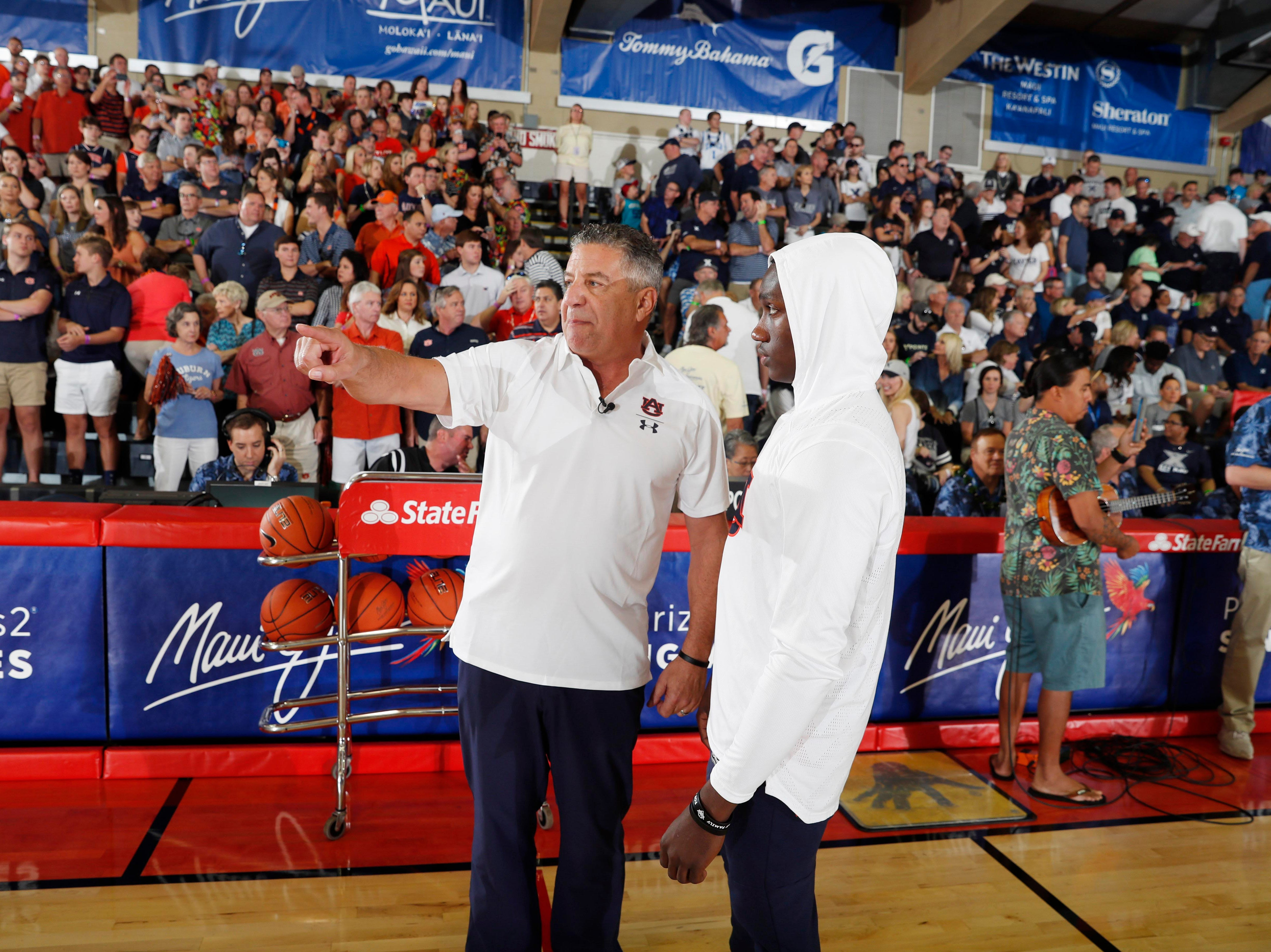 Nov 19, 2018; Lahaina, HI, USA; Auburn Tigers coach Bruce Pearl talks with guard Jared Harper (1) before the game against the Xavier Musketeers during the first round games of the Maui Jim Maui Invitational at Lahaina Civic Center. Mandatory Credit: Brian Spurlock-USA TODAY Sports
