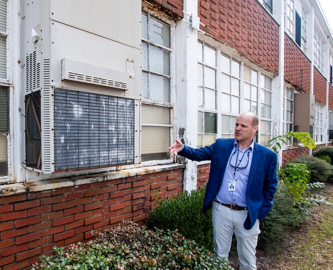 Chad Anderson, Executive Director of Operations for the Montgomery Public Schools, talks about the industrial window units at Goodwyn Middle School in Montgomery, Ala., on Tuesday November 20, 2018.