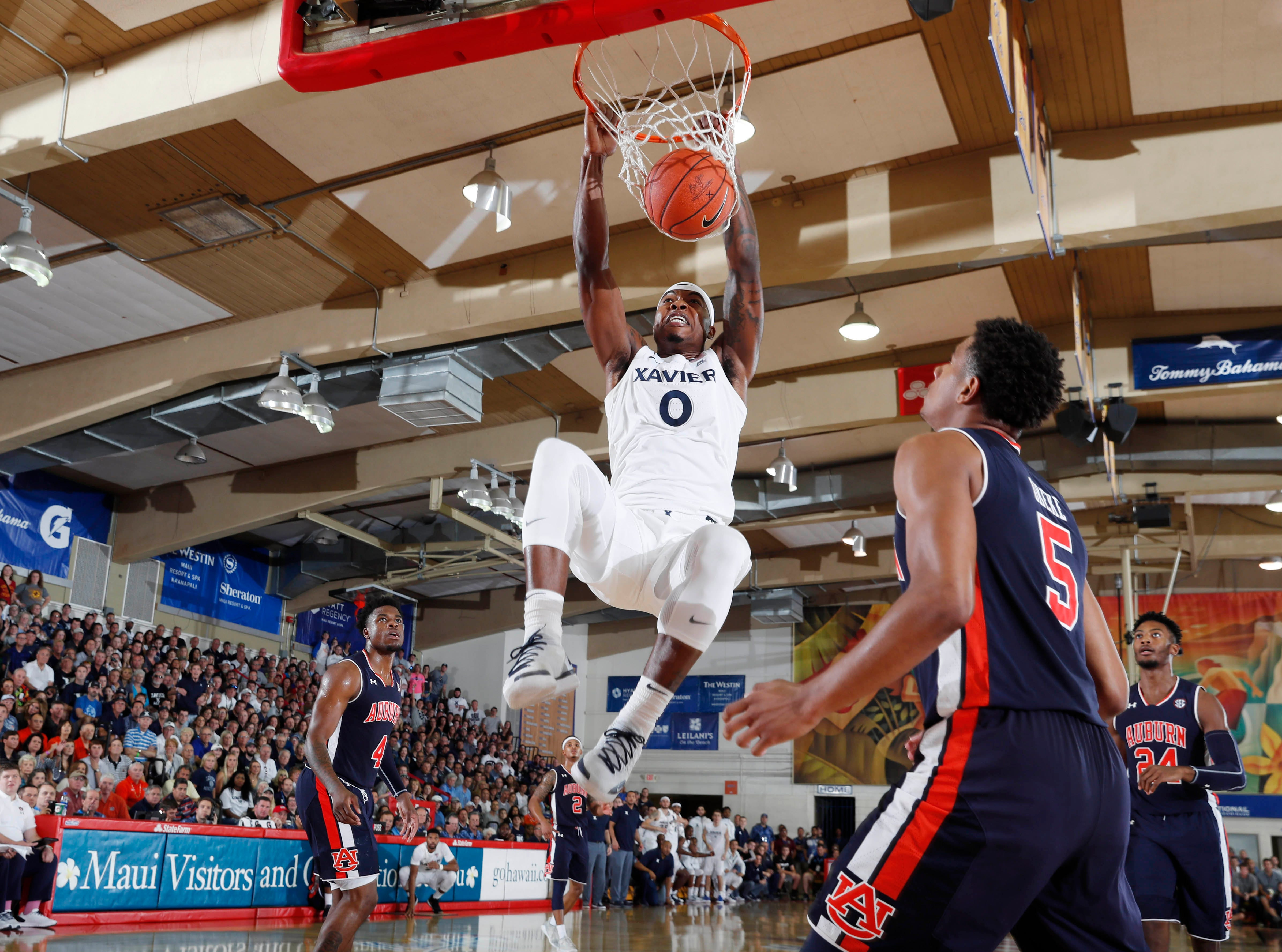 Nov 19, 2018; Lahaina, HI, USA; Xavier Musketeers forward Tyrique Jones (0) dunks against Auburn Tigers forward Chuma Okeke (5) in the first half during the first round games of the Maui Jim Maui Invitational at Lahaina Civic Center. Mandatory Credit: Brian Spurlock-USA TODAY Sports