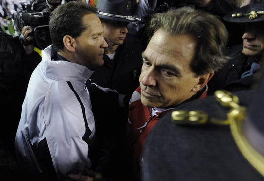 Alabama Coach Nick Saban hugs Auburn Coach Gene Chizik  following the Iron Bowl at Bryant-Denny Stadium in Tuscaloosa, Ala. on Saturday November 24, 2012.(Montgomery Advertiser, Mickey Welsh)