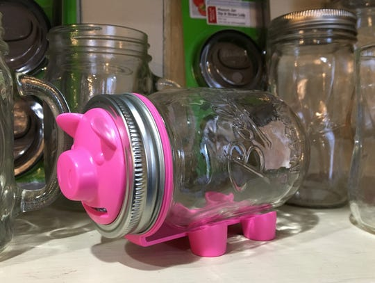 The Minnetrista Orchard Shop sells a wide variety of accessories for Ball jars, including a device that can turn one into a piggy bank.
