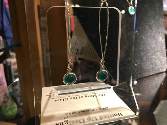 These earrings, sold at the Minnetrista Orchard Shop, are made out of glass Ball jars.