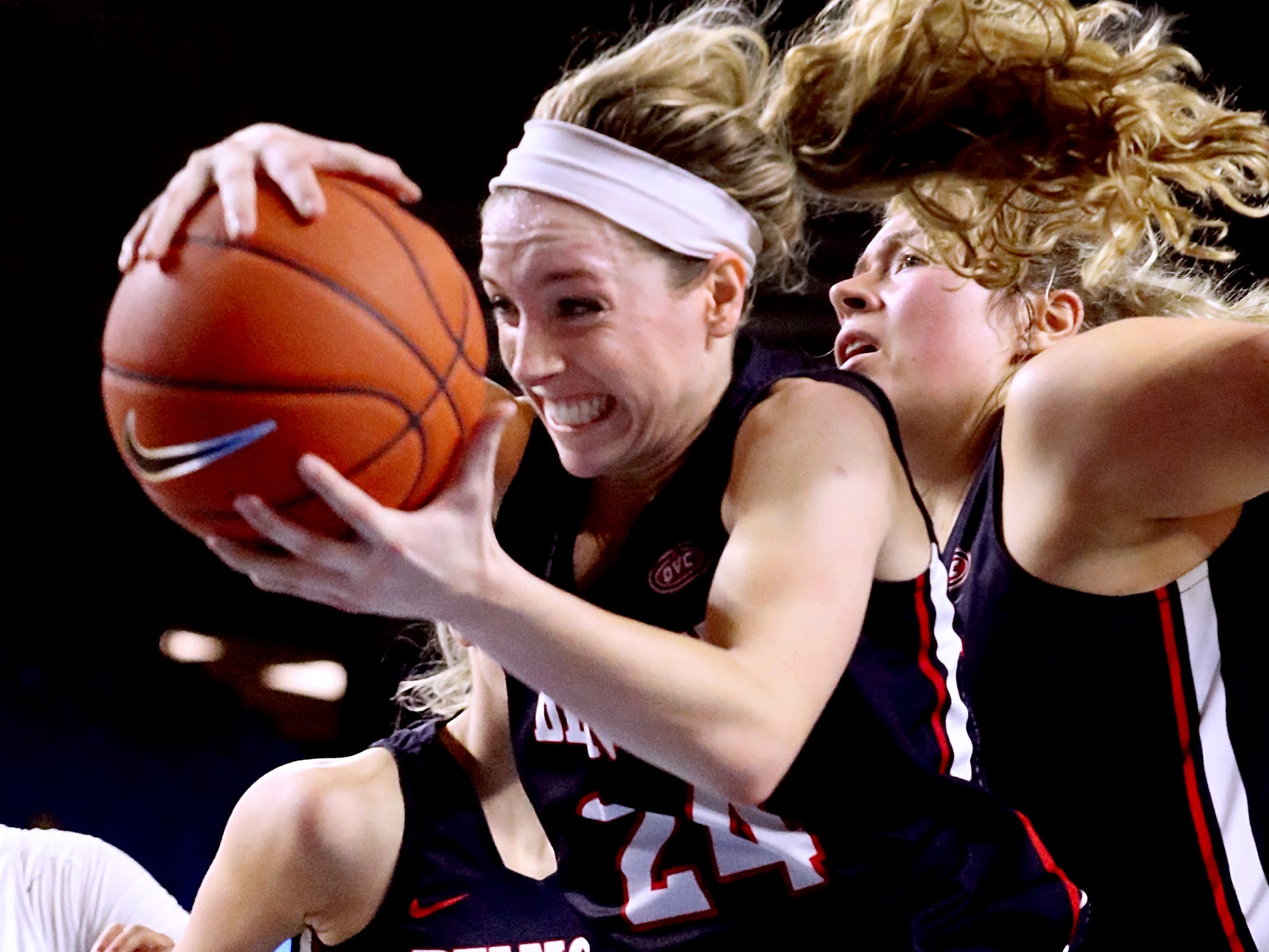 Belmont's Jenny Roy (24) grabs a rebound against MTSU during the game at MTSU on Monday, Nov. 19, 2018.