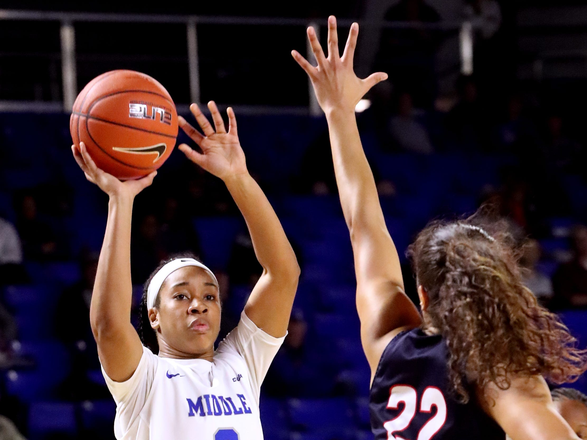 MTSU's Kyla Allison (3) goes up for a basket as Belmont's Maddie Cook (22) guards her during the game at MTSU on Monday, Nov. 19, 2018.