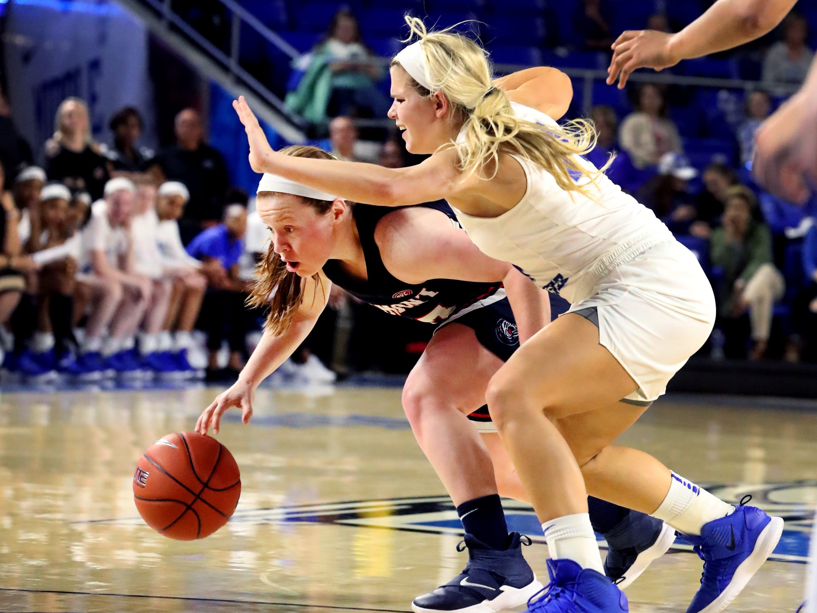 Belmont's Darby Maggard (33) tries to get the ball to the basket as MTSU's Katie Collier (14) guards her during the game at MTSU on Monday, Nov. 19, 2018.