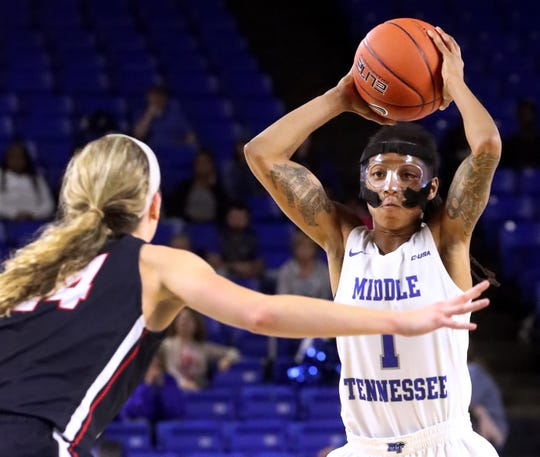 MTSU's A'Queen Hayes (1) looks for an open player as Belmont's Jenny Roy (24) guards her during the game at MTSU on Monday, Nov. 19, 2018.