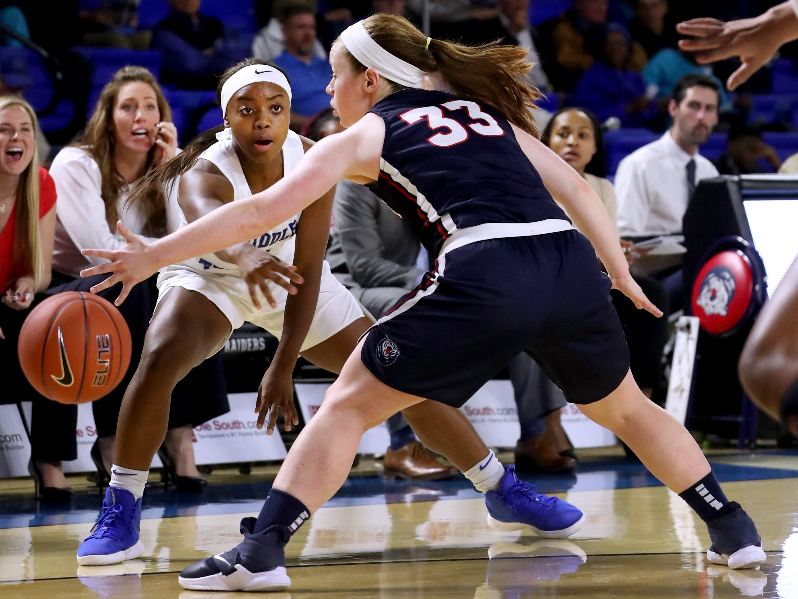 MTSU's Taylor Sutton (2) passes the ball as Belmont's Darby Maggard (33) tries to steal the ball during the game at MTSU on Monday, Nov. 19, 2018.