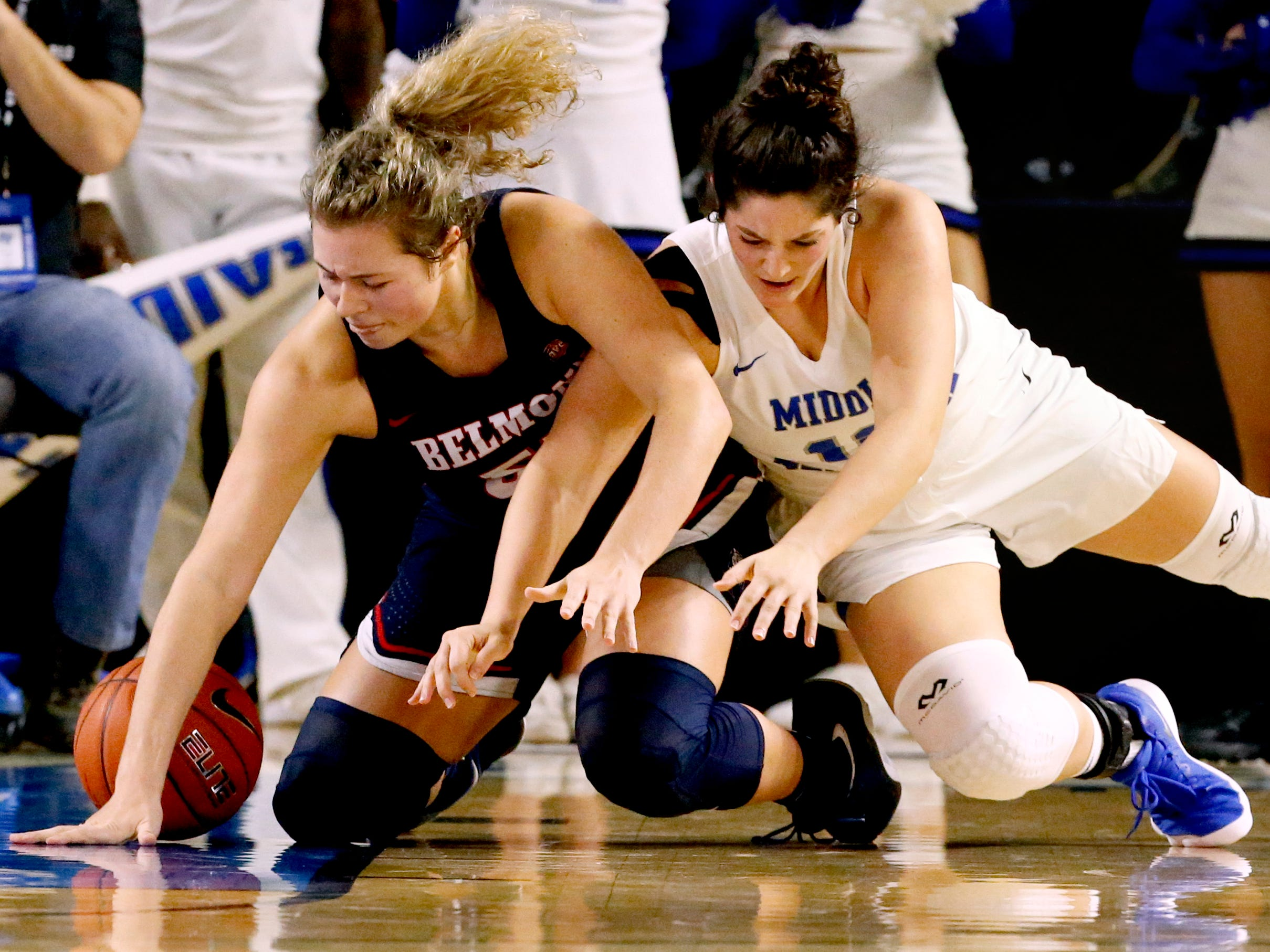 Belmont's Maddie Wright (55) and MTSU's Jess Louro (12) both go after a loose ball during the game at MTSU on Monday, Nov. 19, 2018.