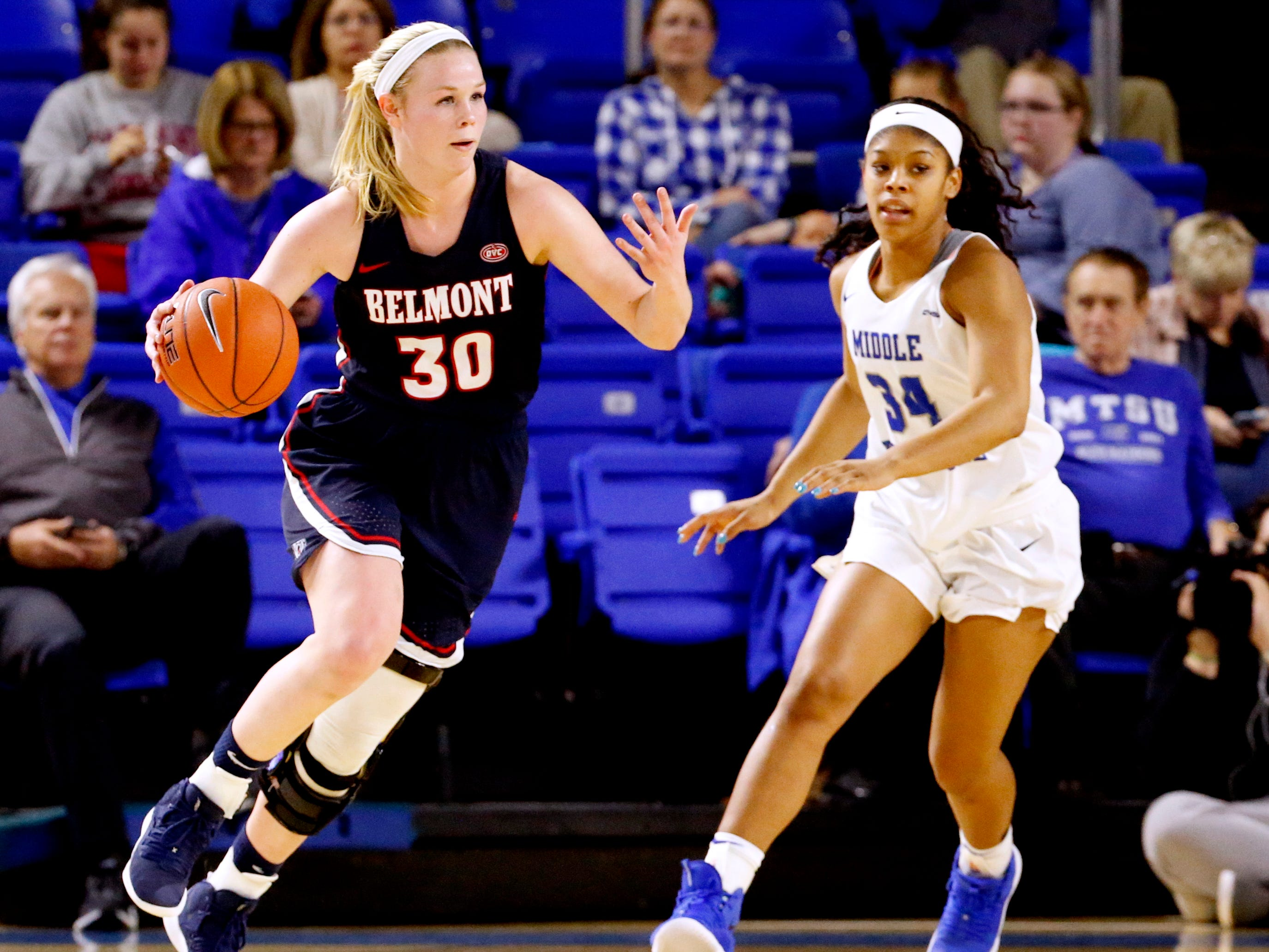 Belmont's Ellie Harmeyer (30) moves the ball around the court as MTSU's Mykia Dowdell (34) comes up from behind during the game at MTSU on Monday, Nov. 19, 2018.